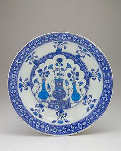 Plate   Origin: Iznik, Turkey   Period: 1525-1535 Ottoman period   Details: Not Available   Type: Stone-paste body painted under glaze   Size: H: 6.8 W: 37.6 cm   Museum Code: F1955.8   Photograph and description taken from Freer and the Sackler (Smithsonian) Museums.
