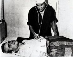 """John McCain's A-4E Skyhawk shot down 10/26/67 by a missile over Hanoi. McCain fractured both arms and a leg ejecting from the aircraft, and nearly drowned when he parachuted into Truc Bach Lake. McCain was transported to Hanoi's main Hoa Lo Prison, nicknamed the """"Hanoi Hilton"""".  His broken arms were improperly set; he never regained complete mobility in his arms. He remained a POW until 3/14/73."""