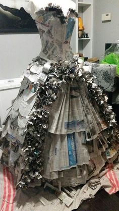 "Newspaper dress--to go along with the ""Dress Rehearsal"" Exhibit.…could also use those toilet paper tubes downstairs as part of the train. Recycled Costumes, Recycled Dress, Recycled Clothing, Recycled Paper Crafts, Recycled Art, Paper Clothes, Paper Dresses, Newspaper Dress, Paper Fashion"