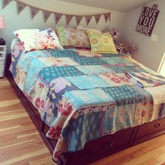 Photo by Kelly Rae Roberts, her bed spread of patchwork Indian fabric
