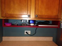 shelf under my cabinet to become our charging station and presto i have more counter space charging station kitchen central office