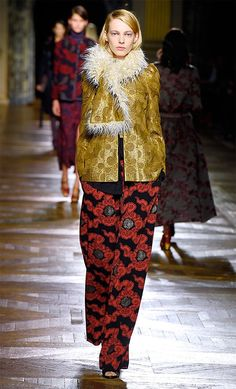 For his fall-winter 2015 collection, Belgian designer Dries Van Noten was in top form with an outing of clothes that were wearable yet far more than mere commerce. Van Noten's eye for color and textile were not missed as he sent down an outing of rich brocades, khakis and faux furs. The silhouette of the season was roomy yet still embraced the feminine form with emphasis at the waist ...