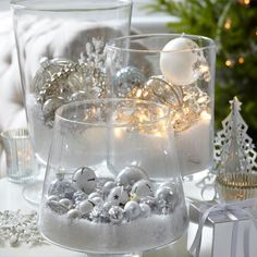 Deck your halls, vases, wreaths and place settings with baubles this Christmas with these innovative display ideas