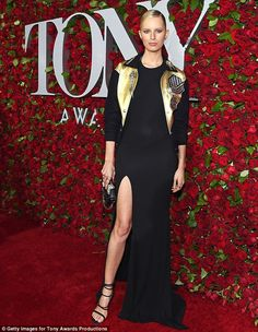 Make a statement: Karolina Kurkova arrived to the Tony Awards in New York City on Sunday evening in an outfit one part glam, one part athletic as she wore a re-imagined version of a varsity jacket over a classic black gown