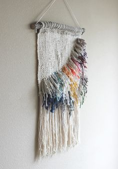 image via Mr. Shaggy is done. I have been saving usable scraps from for the last couple of months, waiting for a reason to recycle them. I finally found one when I saw the photo above of the embroidered lapels by Natalie . That girl knows how to rock some fringe! This weave mea
