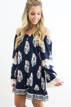 Are you on vacation or just want to pretend you are? Feel like you're walking down the beach in our new Santa Monica Pier navy blue tunic dress. This gorg dress