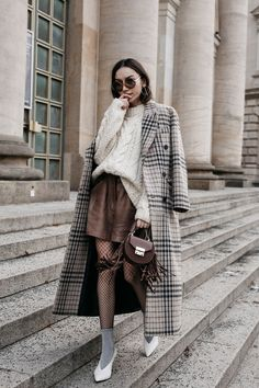 Fashion blogger Beatrice Gutu wearing Mango checked coat with cable knit sweater, fishnet tights with lurex socks and Celine V shaped white pumps trends 2017