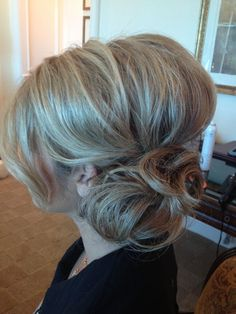 Updo ! I like the side bun with a poof in the back up top. :-)