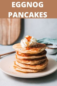 During the holiday season start your day off with these Eggnog Pancakes. You will love these warm, spiced pancakes on Christmas morning or even for a festive brunch. Top with a cinnamon whipped cream and warm maple syrup. // acedarspoon.com #pancakes #eggnog #breakfast #brunch #holidays