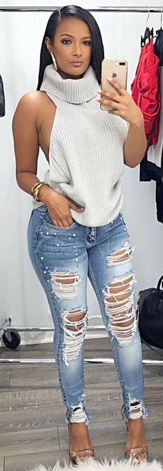 #winter #outfits white turtleneck sleeveless shirt and distressed blue denim jeans