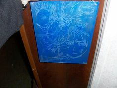 Engraved glass with blue backing