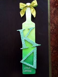 paddle for my big! the ombre makes it kind of hard to read in the picture. the letters are iridescent glitter!