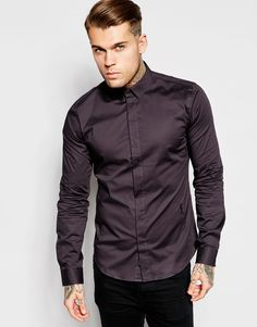 """Shirt by Religion Stretch cotton Point collar Concealed button placket Signature logo Curved hem Regular fit - true to size Machine wash 97% Cotton, 3% Spandex Our model wears a size Medium and is 185.5cm/6'1"""" tall"""