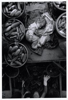© Larry Towell/Magnum Photos Baby on Cucumber Machine, Kent County, Ontario, Canada.
