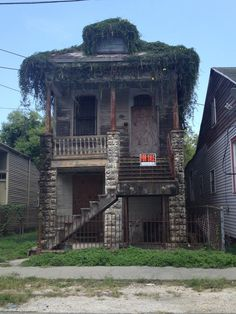 Abandoned house in New Orleans. There used to be stables behind this once beautiful house.