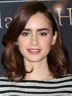 Lily's in Mexico City here and the hair is a new look we haven't seen yet: smooth, bouncy, curled-under waves. It's like ultimate blowout ha...