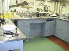 Dental Lab in the USS Hornet's Dental Ward. Uss Hornet, Dental Technician, Dental Laboratory, Smile Design, Workbenches, Clinic, Teeth, Kitchen Cabinets, Technology