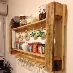 If you are short of space but you need to place your important utensils and  organize them in a proper manner than making use of pallet wood to create a wall hanging cabinet is the perfect idea. Different compartments separated and nails to hang the items that need to be hanged is an innovative use of wood and less space.
