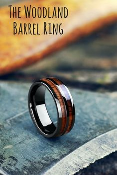 A mens wedding ring designed for the outdoorsman. Extremely durable and waterproof. This wood wedding ring is crafted out of koa wood. #weddingrings