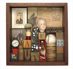 A assemblage box by Leo Kaplan- Based on childhood. It gives a mysterious, creepy sense to it yet it still is relating to childhood. (Maybe something old and untouched from your attic?)
