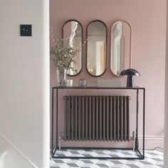 These mirrors are by AYTM and can be found at  Amara Hallway Paint Colors, Pink Paint Colors, Wall Colors, Best Interior Paint, Interior Design, Victorian Terrace Hallway, Victorian Terrace Interior, Hallway Mirror, Hallway Wallpaper