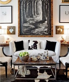 "Chicago Mag - living rooms - eclectic, art gallery, white, slipcover, sofa, black, white, pillows, black, white, cowhide, rug, industrial, coffee table,:    ""the lack of color brings every interesting detail into focus"""