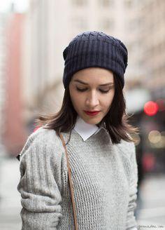 White shirt, grey sweater, beanie, red lips / Garance Doré