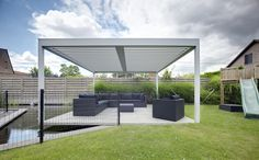 The Umbris patio roof system is highly adaptable to suit your building or your design preferences. Installations can be free standing, post supported, building supported, as well as cantilevered | St Lawrence | UmbrisbyIQ