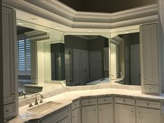Custom modification on a old vanity - Added upper cabinets, mirrors low voltage recess lights - white carrera marble