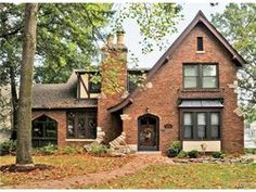 Stunning English Tudor--2-Story 3+bedroom 2.5-bath updated charming home in much desired Webster Hills! At Lockwood & Berry! Brick & Stone elevation, dry stacked Limestone walls, winding walking path which leads to foyer w/tiled entry leading onto beautiful hardwood flooring & flowing into Living & Dining & Den(possible 4th bedroom); Adjoining the Living rm with 2 door access is a Sunroom w/stone tile flooring, a great window line & view of the backyard.