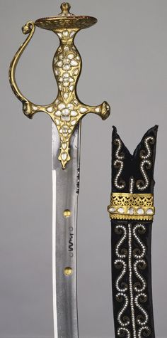 Talwar and scabbard. Acquirer: King Edward VII, King of the United Kingdom (1841-1910). Provenance: Presented to Albert Edward, Prince of Wales by Sir Rajinder Singh, Maharaja of Patiala, during his visit to India in 1875-6. Steel, iron, silver, gold, diamonds, rubies, seed pearls and velvet covered wood.