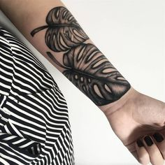 Monstera Deliciosa Leaf tattoos that you can filter by style, body part and size, and order by date or score. Tattoofilter is a tattoo community, tattoo gallery and International tattoo artist, studio and event directory. Shark Tattoos, Leg Tattoos, Flower Tattoos, Tribal Tattoos, Sleeve Tattoos, Tatto Old, S Tattoo, Monstera Deliciosa, Hannah Tattoo