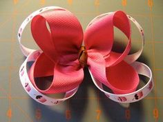 Make a boutique style hair bow. Step by step instructions with photos.
