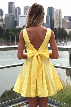 TIE BOW BACK DRESS   the front looks like it fits funny:/