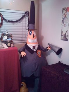 DIY Nightmare Before Christmas Halloween Props: Life-Size DIY Mayor (of Halloween Town) Prop.  I know I'm totally a geek (and I rather enjoy being one), I'd really find a place in my home for this.
