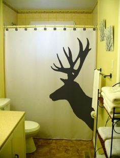 Fabric shower curtain a.k.a upholstery fabric? This is painted, so gives me an idea for my living room upholstery projects (Thanks Mom and Nate)  deer tracks in stead of deer heads?