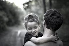 Son holding onto his Daddy