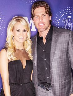 Carrie Underwood and her husband Mike Fisher. Carrie Underwood Makeup, Carrie Underwood News, Carrie Underwood Family, Carrie Underwood Mike Fisher, Country Music Stars, Country Singers, Small Town Girl, Famous Couples, Celebs