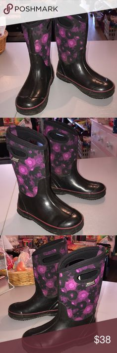 Bogs 3 waterclr flowers waterproof boots Bogs 3 waterclr flowers waterproof boots in gently worn clean condition. Overall gently used. The neoprene is clean. The shiney part of the boots have some soiling and scuffs. They don't detract but they are shown in the pics number 5 abc 6. Consigned to my boutique no trades. Bogs Shoes Rain & Snow Boots