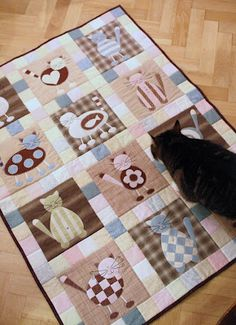 Cat quilt--tutorial on her website!  Would change colors, but cute!
