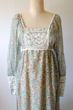 Oh my goodness!  I made myself a dress like this in 1974!  It had short puffed sleeves and was a yellow floral print.  This takes me back.  I still have this dress in my closet.  Never could bring myself  to get rid of it.