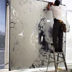 """""""Marble"""" on metallic silver being installed in our Vancouver showroom Crown Wallpaper + Fabrics"""
