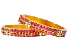 Gold bangle pair studded with burmese rubies and uncut diamonds, from Karni Jewellers.