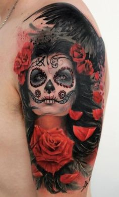 A beautiful photo realistic tattoo of rose flowers and a girl with sugar skull face paint by Alex de Pase. The portrait of the woman and the rose flowers are all tattooed in a photo-realistic style, but some of the floral designs and the crow's wing in the background are more abstract and artistic, adding to the art work without being a part of the photo-realistic styling. [source]