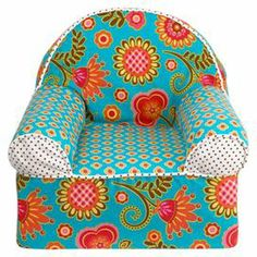 "The perfect addition to your child's bedroom, this bohemian-inspired arm chair features eclectic upholstery and foam cushioning.  Product: ChairConstruction Material: Cotton and polyurethane foamColor: MultiFeatures: Removable coverDimensions: 18"" H x 17"" W x 16"" DCleaning and Care: Cover is machine washable"