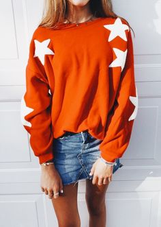 8973cab869c1e cosy orange jumper with stars and a denim skirt
