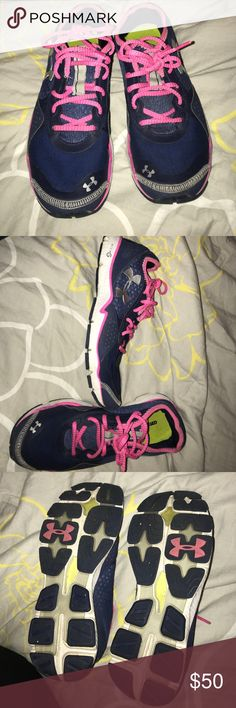 Under armour tennis shoes Size 8.5. Like new. No problems, just don't fit me anymore. No problem areas. Colors are navy blue and bright pink and silver logo Under Armour Shoes Athletic Shoes