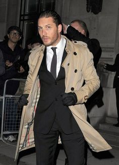 Tom Hardy in Burberry suit and trench. Gloves.