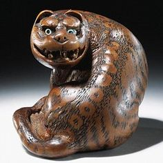 Netsuke, Tomin, Japan, about late 18th or early 19th century. Museum no. A.939-1910.  Victoria and Albert Museum.  London, England