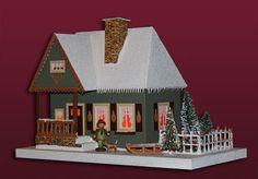Forsthaus mit beleuchtetem Weihnachtsbaum - http://www.erzgebirgsstuebchen.de